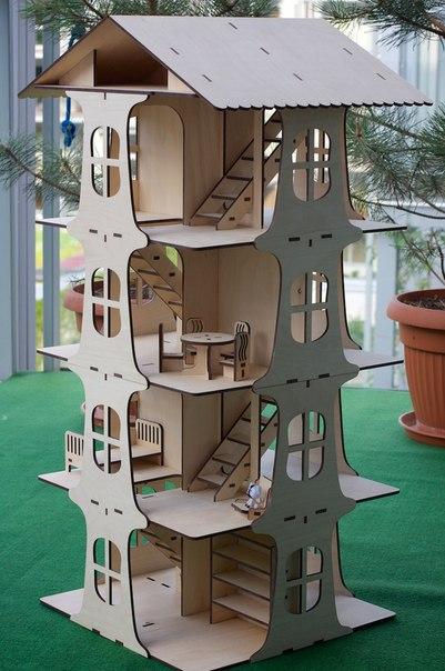 Casa de muñecas de tres pisos
